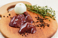 Fresh raw chicken liver. With spices on cutting board. Cooking food Stock Photo