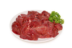 Fresh raw chicken livers on the plate against a white background. Fresh raw chicken livers on the plate isolated Stock Image