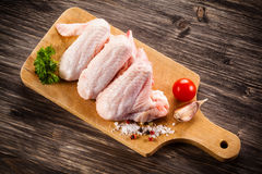 Fresh raw chicken lwings. Fresh raw chicken wings on white background Stock Photo