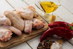 Fresh raw chicken meat on wooden background. Fresh raw chicken wings on wooden board on white table. Selective focus Royalty Free Stock Photo