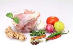 Fresh raw chicken pieces, vegetables and spices Stock Photography
