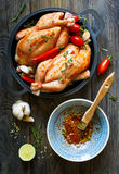 Fresh raw chicken. Preparation for roasting chicken with herbs and spices Royalty Free Stock Photo