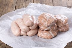 Fresh raw chicken sausages and burgers royalty free stock photo
