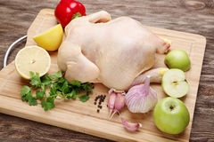 Fresh raw chicken. And vegetables prepared for cooking Royalty Free Stock Photos