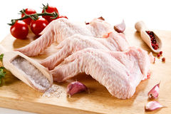 Fresh raw chicken wings. On white background Stock Image