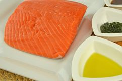 Fresh, Raw Chinook Salmon Fillet. Raw Chinook Salmon Fillet With Olive Oil And Dill Royalty Free Stock Photos
