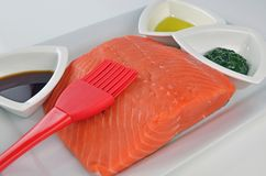 Fresh, Raw Chinook Salmon Fillet. Raw Chinook Salmon Fillet With Olive Oil And Dill Royalty Free Stock Image
