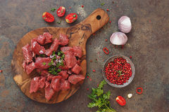 Fresh raw chopped angus beef on a wooden cutting board Stock Photos
