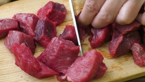 Fresh raw chopped beef. Cooking goulash with beef meat. stock video footage