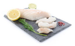 Fresh raw cod fillet on a slate plate Royalty Free Stock Images