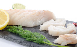 Fresh raw cod fillet on a slate plate Royalty Free Stock Photography