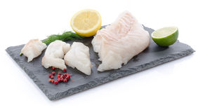 Fresh raw cod fillet on a slate plate Royalty Free Stock Photos