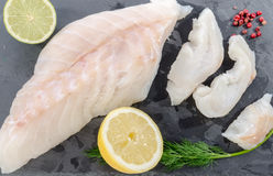 Fresh raw cod fillet on a slate plate Stock Photos