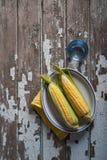 Fresh raw corn on a wood table. Fresh corn on a wood table Stock Photography
