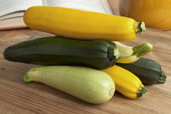 Fresh raw courgettes in different colors. Pile of fresh raw courgettes in different colors Royalty Free Stock Photography