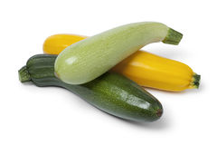 Fresh raw courgettes in different colors. On white background Royalty Free Stock Photo