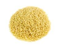 Fresh raw couscous isolated on white background. Detailed studio shot Royalty Free Stock Image