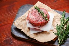 Fresh raw cutlets for burger from beef. wooden background, rustic style.  Stock Photo