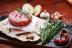 Fresh raw cutlets for burger from beef. wooden background, rustic style.  Stock Images