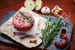 Fresh raw cutlets for burger from beef. wooden background, rustic style.  Stock Photography