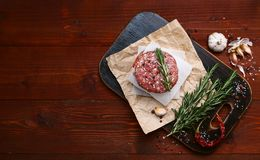 Fresh raw cutlets for burger from beef. wooden background, rustic style.  Stock Photos