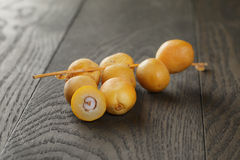 Fresh raw dates on table. Old oak wood Stock Photography