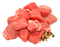 Fresh Raw Diced Beef. Fresh raw uncooked diced beef meat with peppercorns isolated on a white background Royalty Free Stock Images
