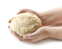 Fresh raw dough in bakers hands. On a white background Royalty Free Stock Images