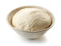 Fresh raw dough. Bowl of fresh raw dough isolated on white background Stock Image