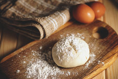 Fresh raw dough. Eggs and tablecloth on a table Stock Photo