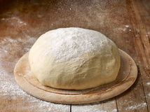 Fresh raw dough. Flour falling on fresh raw dough Stock Images