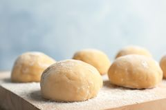 Fresh raw dough with flour. On wooden board Royalty Free Stock Photos