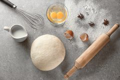 Fresh raw dough with ingredients. On table Stock Photography