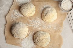 Fresh raw dough with poppy seeds and flour. On table, top view Stock Photos
