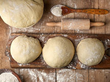 Fresh raw dough. On rustic wooden table, top view Stock Photos