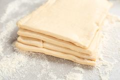 Fresh raw dough on table. Puff pastry Royalty Free Stock Photos