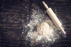 Fresh raw dough on wooden background. Fresh raw dough on  wooden background Royalty Free Stock Photo