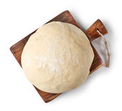 Fresh raw dough. On wooden board isolated on white background, top view Royalty Free Stock Photography