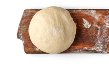 Fresh raw dough on wooden board. Top view Stock Photo