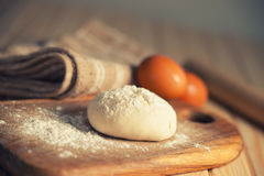 Fresh raw dough. On a wooden cutting board Royalty Free Stock Photos