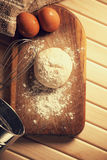 Fresh raw dough. On a wooden cutting board Stock Photography