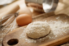Fresh raw dough. On a wooden cutting board Stock Image