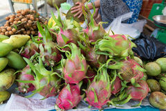 Fresh raw dragon fruit heap on open market.  Royalty Free Stock Photography