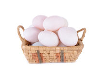 Fresh raw duck eggs in the basket and on white background. Fresh raw duck eggs in the basket and on a white background Royalty Free Stock Photo