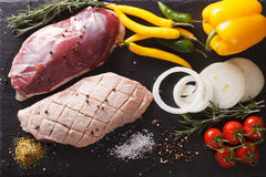 Fresh raw duck fillet with ingredients close-up on the table. ho. Rizontal view from above Royalty Free Stock Image