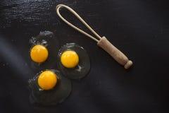 Fresh raw egg. Presentation of fresh and raw eggs on the black floor of pumice Stock Photos