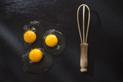 Fresh raw egg. Presentation of fresh and raw eggs on the black floor of pumice Stock Image