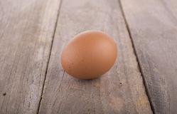 Fresh raw egg on wooden table. Whole fresh raw egg on wooden table Royalty Free Stock Images