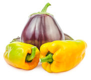 Fresh raw eggplant with yellow bellpeppers isolated. On white background Stock Photo