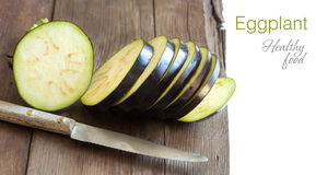 Fresh  Raw eggplants with knife. On the wood background Royalty Free Stock Photography